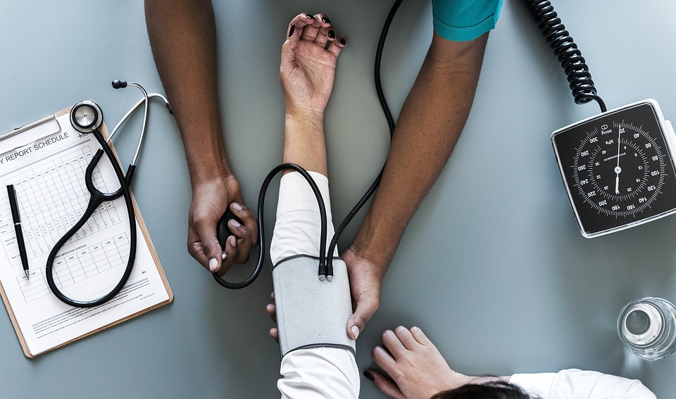 free stock image, person checking patient's blood pressure